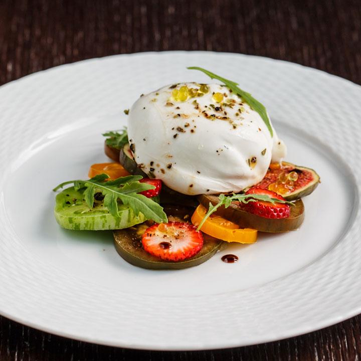 Creamy burrata with greenheart heirloom tomatoes